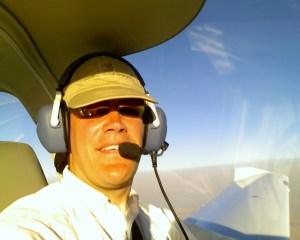 Otto flying, pilot posing